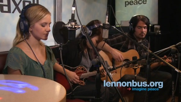 "Carmen & Camille perform a cover of Led Zeppelin's ""Battle of Evermore"" on the John Lennon Bus"